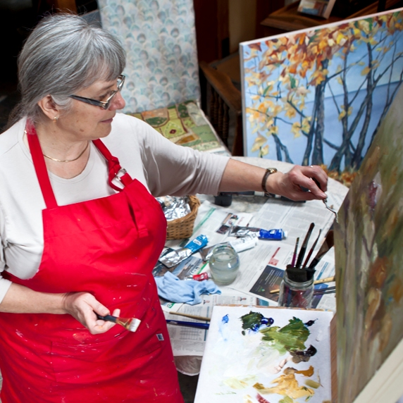 Terrill Welch painting in her studio by Allison Mullally